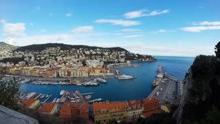 Panoramic view of Nice coastline and port with blue sky, France.