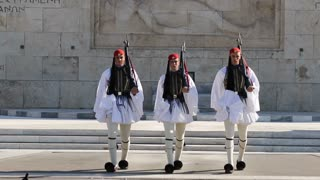 Greece, Athens, November 26, 2017: Greek national guards (Evzones) in front of the Tomb of the Unknown Soldier near building of Parliament. Changing of the Guard, Athens, Greece