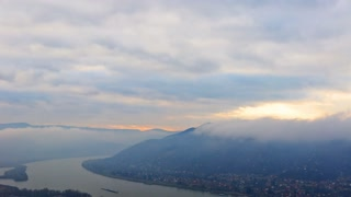 timelapse of the mouth of the Danube cloudy sky river and hills