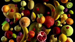 fruits fall on black animation looped