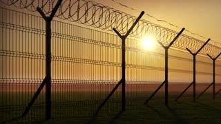 boundary fence on sunset animation looped