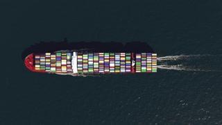 Cargo ship in the ocean, top view