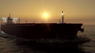 oil tanker in the ocean on sunset