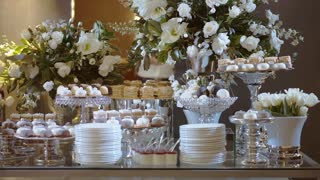 Candy Bar In The Banquet Hall. Candy Buffet. Many Kind of Dessert. Cupcakes On The Table. Closeup And Rotate.