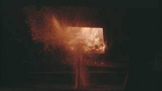 Closeup Of Burn Straw Pellets In Boiler. Flames And Fire Details. Ecologic Fuel Use For House Heating