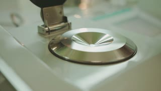 Juice analysis. Analysis of juice sample on laboratory equipment. Modern equipment. Scientist put glass with juice in laboratory equipment for research. Food quality test