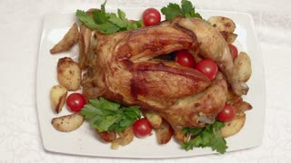 Roasted Chicken On The Table During A Family Dinner. Close Up View.