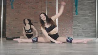 Young Beautiful Girl Training Sensual Pole Dance
