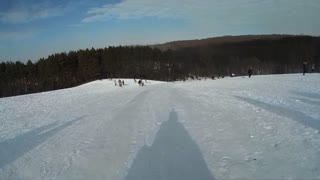 man riding on a sled fron the hill POV go pro