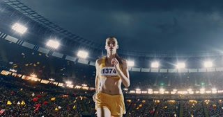Track and field female  runner on the arena