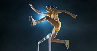 Track and field runner hurdles on sports arena