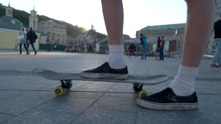 15. 09. 2016 Kyiv, Ukraine. Legs riding on skateboard. Foot of skateboarder pushing ground. Brake the rules. Motion and speed.
