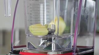 Apple, orange, banana and grapefruit whipped in a blender. Fresh fruit cocktail.