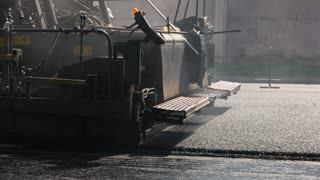 Asphalt paver machine. Cars moving on road. Built to last. Improve traffic safety.