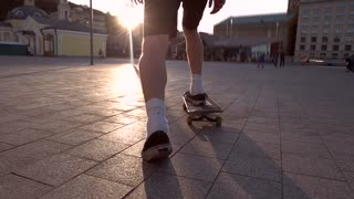 Back view of skateboarder. Skater in slow motion. Stay young and fearless. When entire life is ahead.