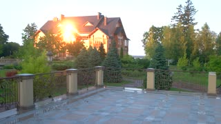 Big house and nature. Park and building in summer. Luxury real estate for sale.