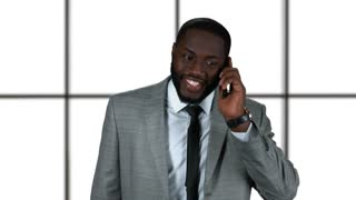 Black businessman on the phone. Smiling guy isolated. Asking coworker for a date.