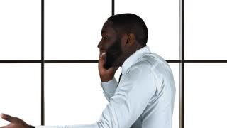 Black man with phone isolated. Guy talking and gesturing. Leading the company to success.