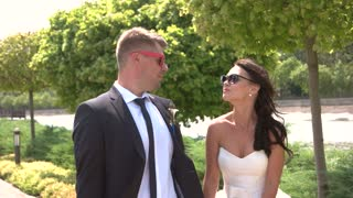 Bride and groom in sunglasses. Wedding couple kissing outdoors. Pull me closer. Magnetism of love.