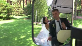 Bride and groom in vehicle. Wedding couple in the mirror. Our journey into new life. Young and happy.