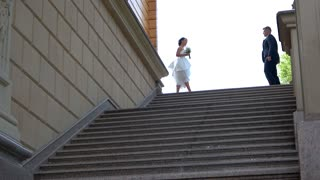Bride and groom near stairs. Wedding couple kissing and hugging. Step towards love and happiness. We are a family now.