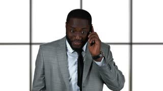 Businessman smiling and phone talking. Black man wearing a suit. Looking forward to meeting you.