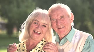 Couple of seniors outdoor. Man and woman are smiling. Find the greatest happiness. Live and love each other.