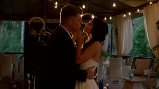 Dance of wedding couple. Bride kissing groom. You're my dream come true. Calm and romantic atmosphere.