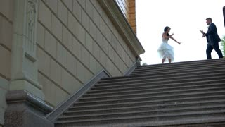 Dancing wedding couple. Bride and groom beside stairs. Come on, dance with me. In the rhythm of happiness.