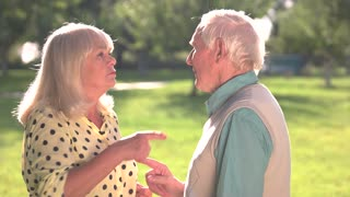 Elderly couple arguing. Woman pointing finger at man. You are so wrong. Problems that test feelings.