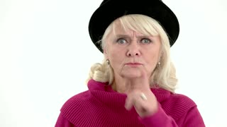 Elderly woman showing silence gesture. Lady with finger on lips. Learn to keep secrets.