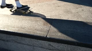 Feet of skateboarder. Skateboarding trick in slow-mo. Check out the new skatepark. Grind and flip.