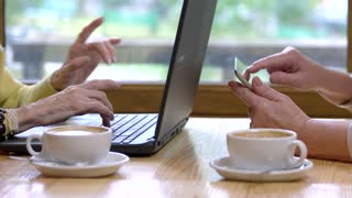Female hands using gadgets. Laptop, tablet and coffee cups. Join social media.
