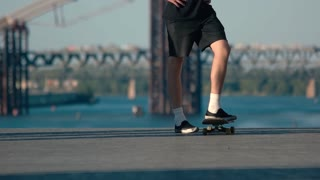 Foot standing on skateboard. Skateboarder wearing shorts. Skateboarding as a lifestyle. My city is my playground.