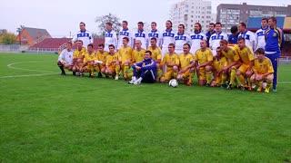 Football players team group on stadium.