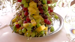 Fruit tower on tray. Grapes and sliced pineapple. Fresh juicy fruits.