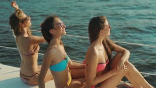 Girls sunbathing on a yacht. Girl on vacation. Traveling on a yacht at sea. Rest on a yacht.