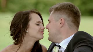 Groom and bride kissing. Newlyweds are smiling. Instead of a thousand words. Seek and find happiness.