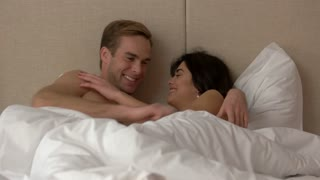 Guy and girl in bed. Couple talking to each other. Do you trust me. Words that come from heart.