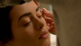 Hand plucking eyebrows. Face of young female. Professional visagist and model. Perfection of beauty.