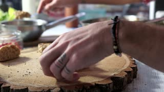 Hands prepare sandwiches. Bread with duck pate. Healthy cooking recipes.