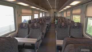 Interior of modern train wagon. Most comfortable conditions for passengers.