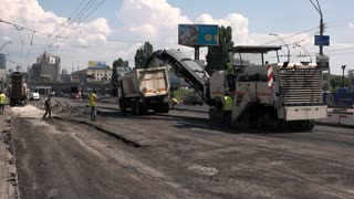 Kiev, Ukraine - 27. 07. 2016. Asphalt milling machine in motion. Urgent repair of the road. Important task for building company.