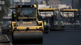 Kiev, Ukraine - 27. 07. 2016. Asphalt roller on the road. Machines facilitate labor of people. Thorough road repair.