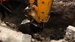 Kiev, Ukraine - 27. 07. 2016. Excavator bucket digs ground. City will get new roads. Work is going as planned.