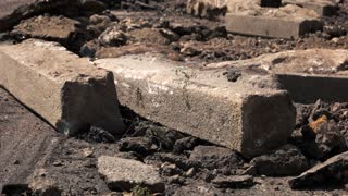 Kiev, Ukraine - 27. 07. 2016. Excavator on the road. Roads need capital repair. Concrete and dirt.