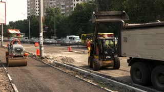 Kiev, Ukraine - 27. 07. 2016. Machinery and road workers. New task for building company. Repair all town roads.