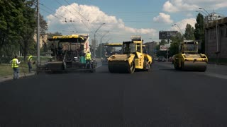 Kiev, Ukraine - 27. 07. 2016. Road rollers in the street. Planned repair of highway. People work double shifts.