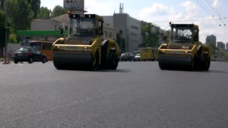 Kiev, Ukraine - 27. 07. 2016. Road rollers on the street. Quality repair of highways. Modern equipment facilitates work.
