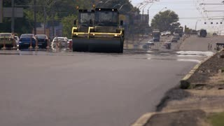 Kiev, Ukraine - 27. 07. 2016. Two asphalt rollers on road. Fast repair of highway. New machines make work easier.